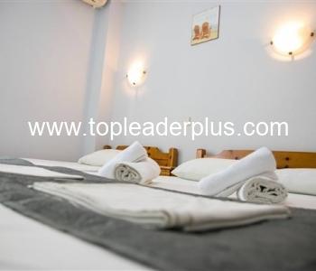 Продажба на сграда с апартаменти за нощувки в слънчева Неа Врасна, Гърция